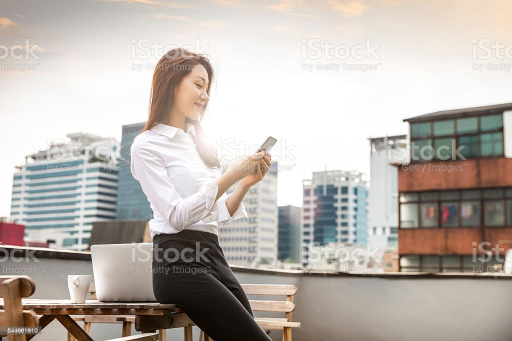 Woman working on the rooftop in Soul stock photo