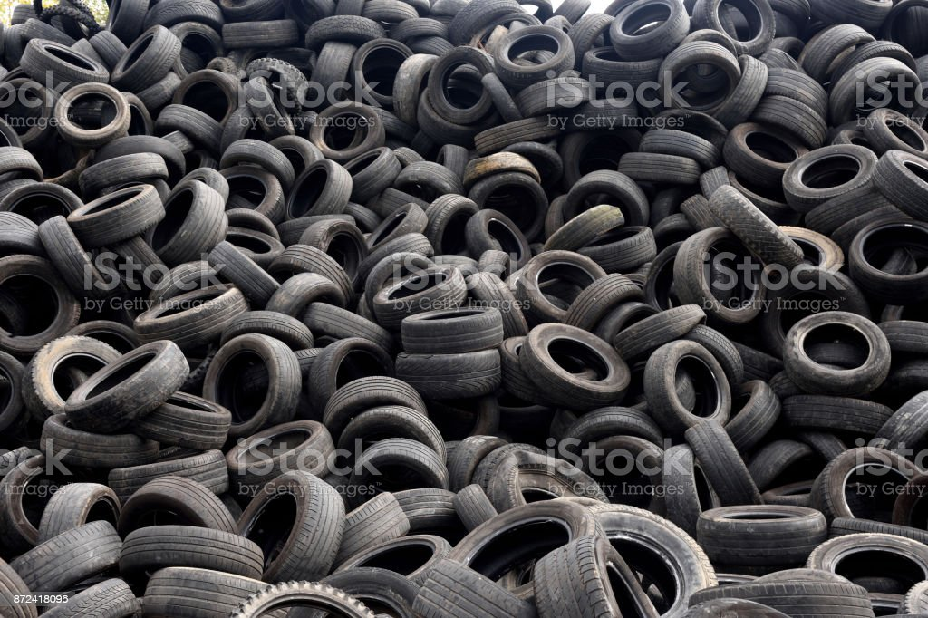 woman working on tire recycling stock photo