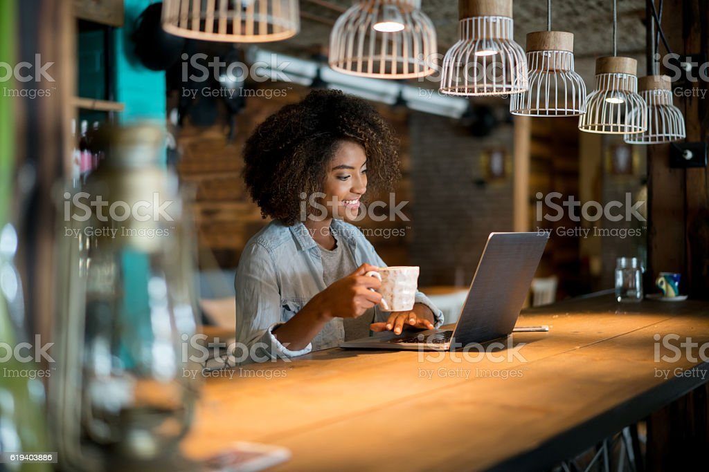 Woman working online at a cafe stock photo