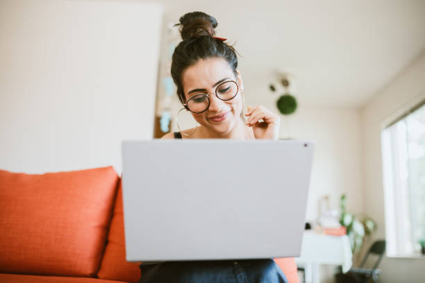 Woman Working Online On Laptop At Home
