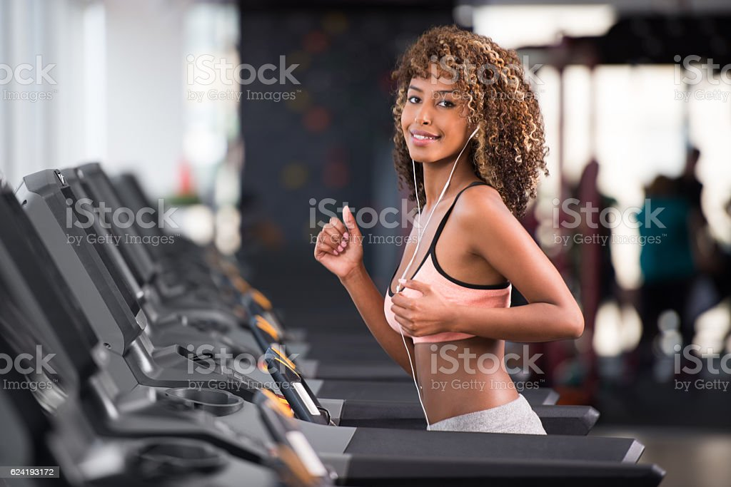 Woman working out at fitness club. stock photo