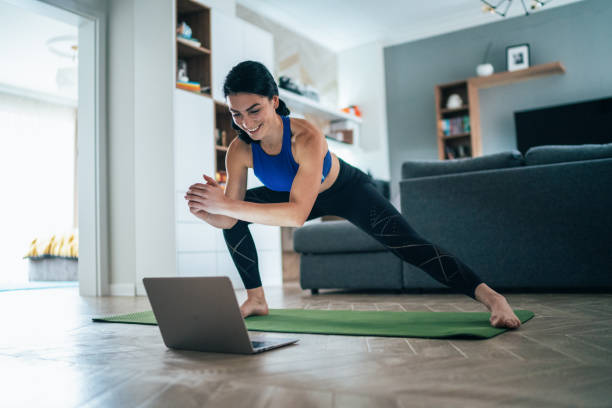 Woman working out at home stock photo