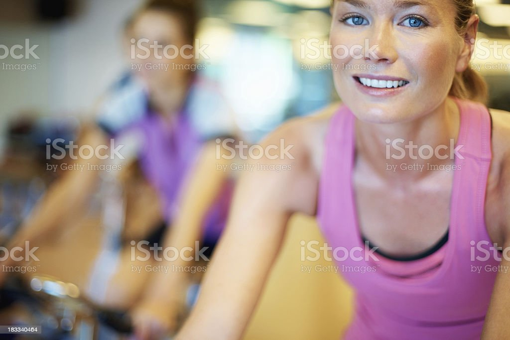 Woman working out during spinning class royalty-free stock photo