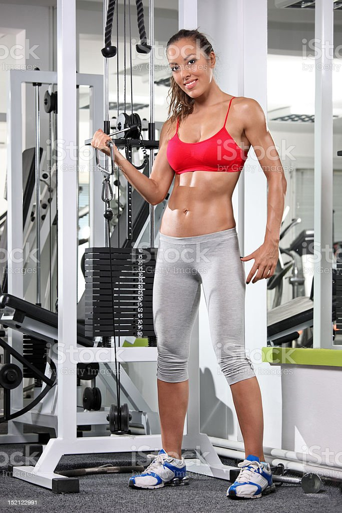 Woman working out on a fitness equipment royalty-free stock photo