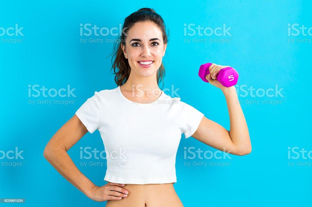 Mulher s'exercitando com haltere foto royalty-free