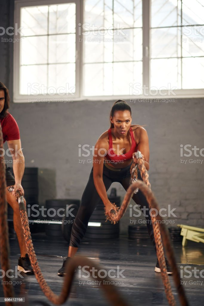 Woman working out with ropes stock photo