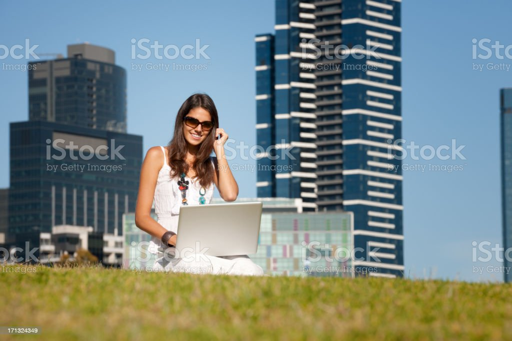 Woman Working Outdoors on her Laptop royalty-free stock photo