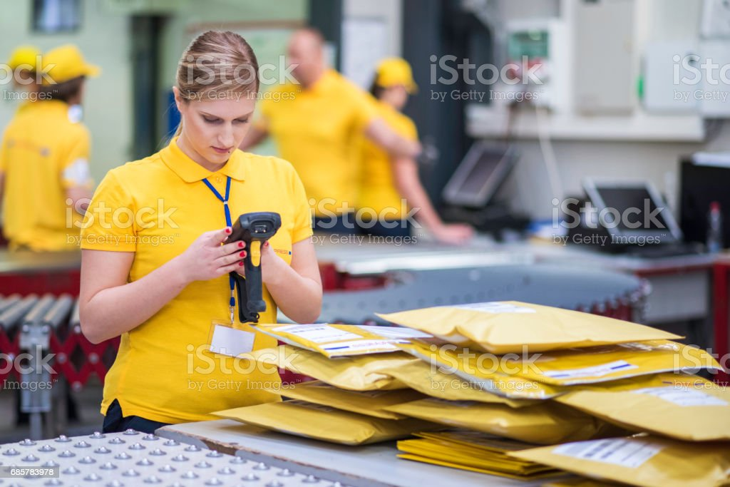 Woman working with bar code reader royalty-free stock photo