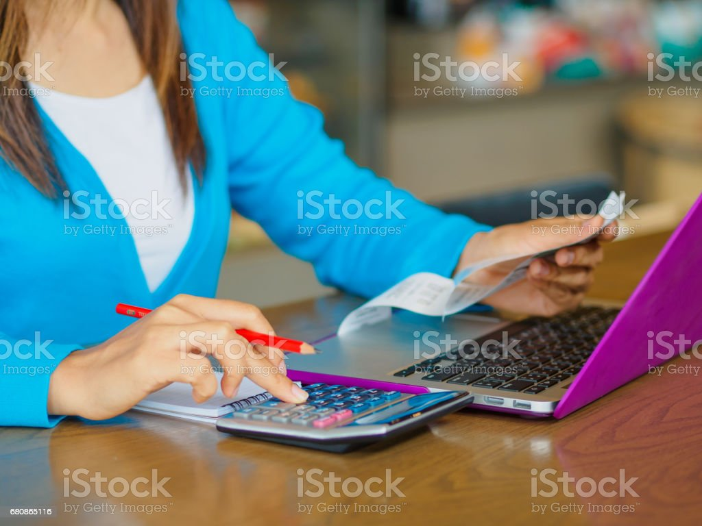 woman working with calculator, stock photo