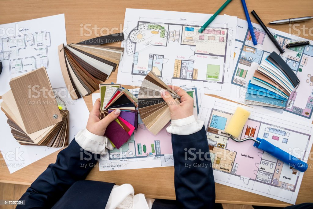 woman working with color palette with house plan stock photo