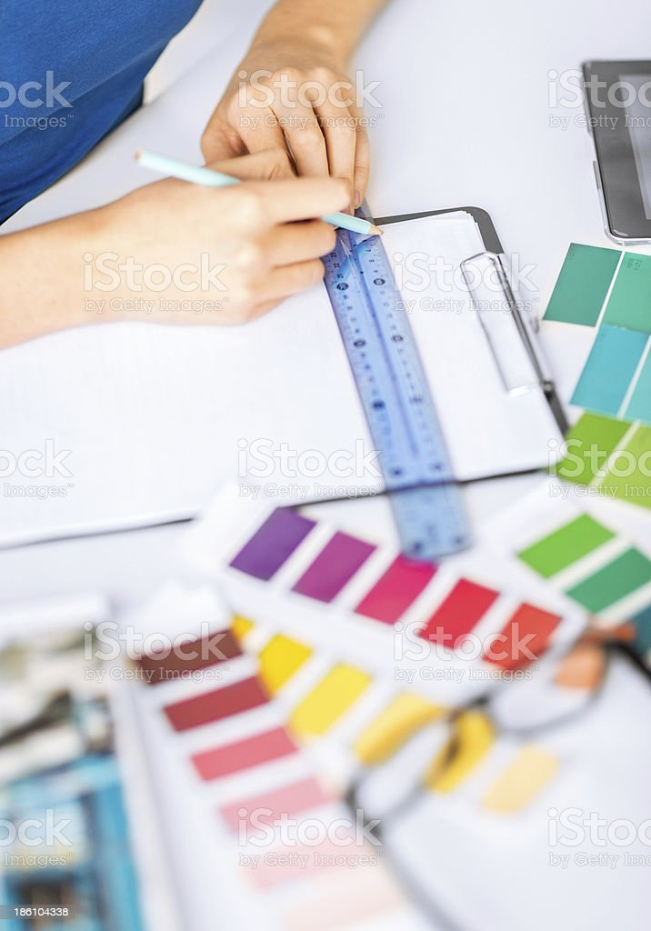 woman working with color samples for selection royalty-free stock photo