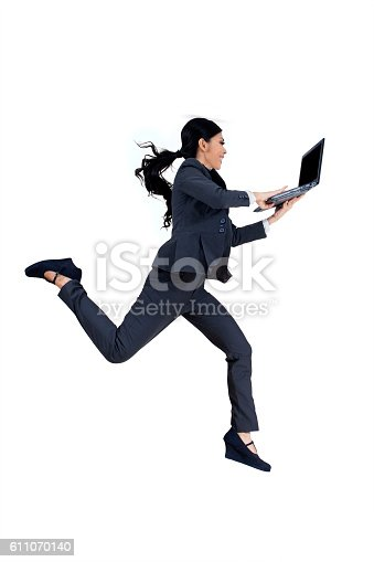 Image of female entrepreneur running in the studio while working with laptop computer, isolated on white background