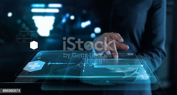 istock woman working with medical network on virtual screen interface in hospital background,  medical technology network concept. 695360574