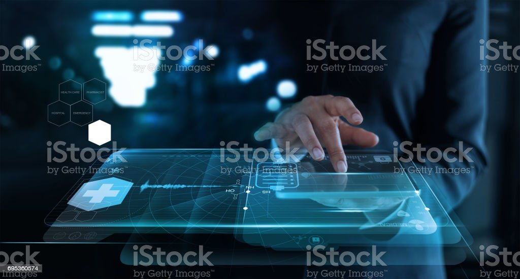 woman working with medical network on virtual screen interface in hospital background,  medical technology network concept. stock photo