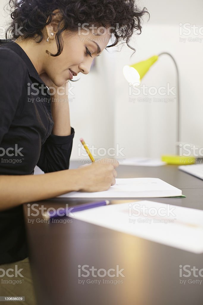 Woman working with sketches in fashion design studio royalty-free stock photo
