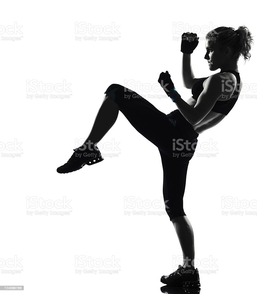 woman workout fitness fighting stance kicking posture stock photo