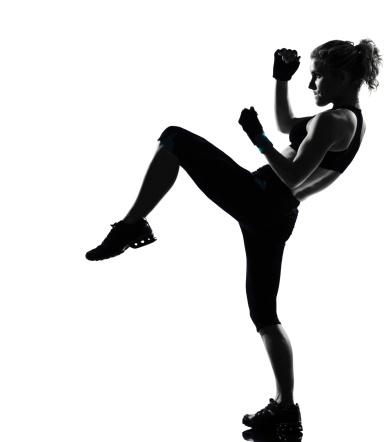 woman workout fitness fighting stance kicking posture