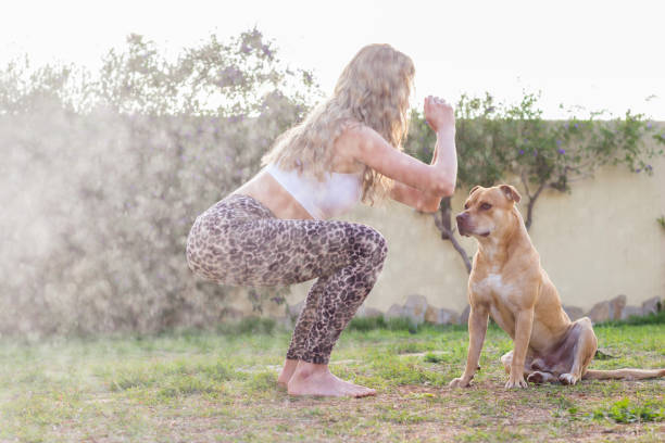 Woman workout with dog