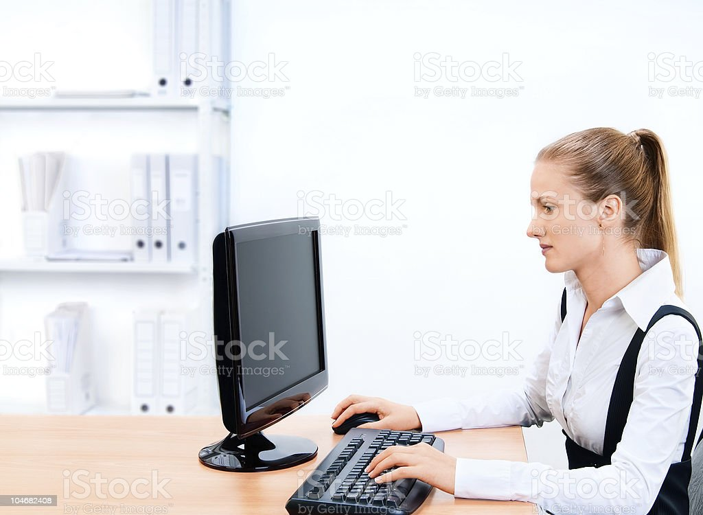 Woman works at the computer. Screen has a clipping path. royalty-free stock photo