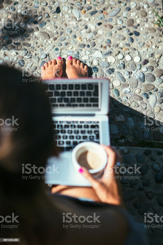 Woman works with laptop and coffee royalty-free stock photo