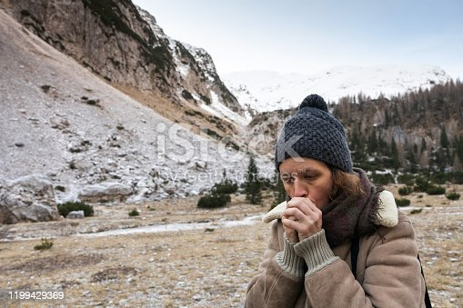 Woman Worming up Hands on a Cold Winter day
