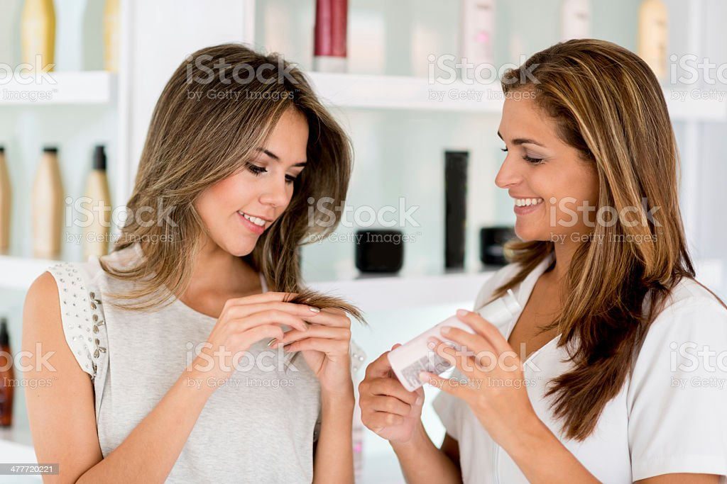 Woman worried about her split ends stock photo
