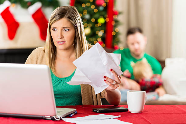 woman worries about how to pay bills during the holidays - holiday and invoice family foto e immagini stock