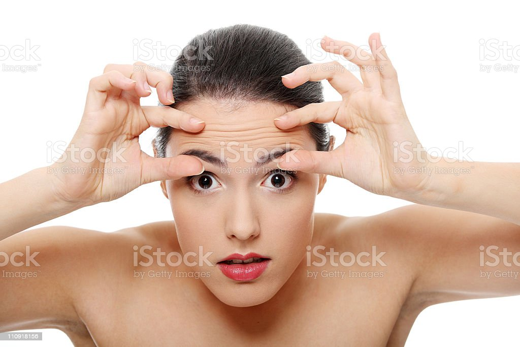 Woman worrying about her first wrinkle stock photo