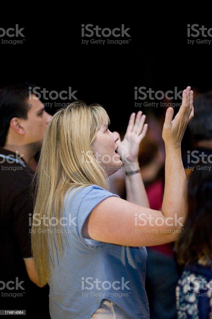 Woman worshipping in Church stock photo