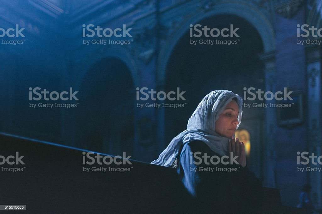 woman worships at a church stock photo