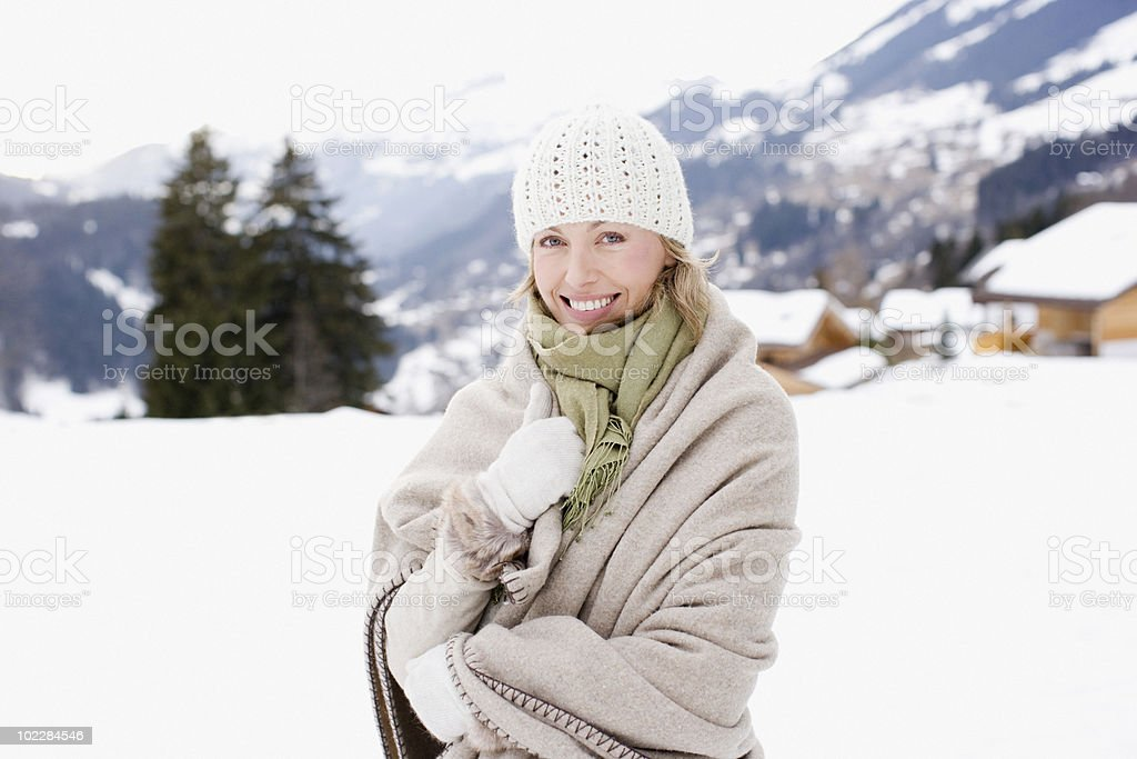 Woman wrapped in blanket stock photo