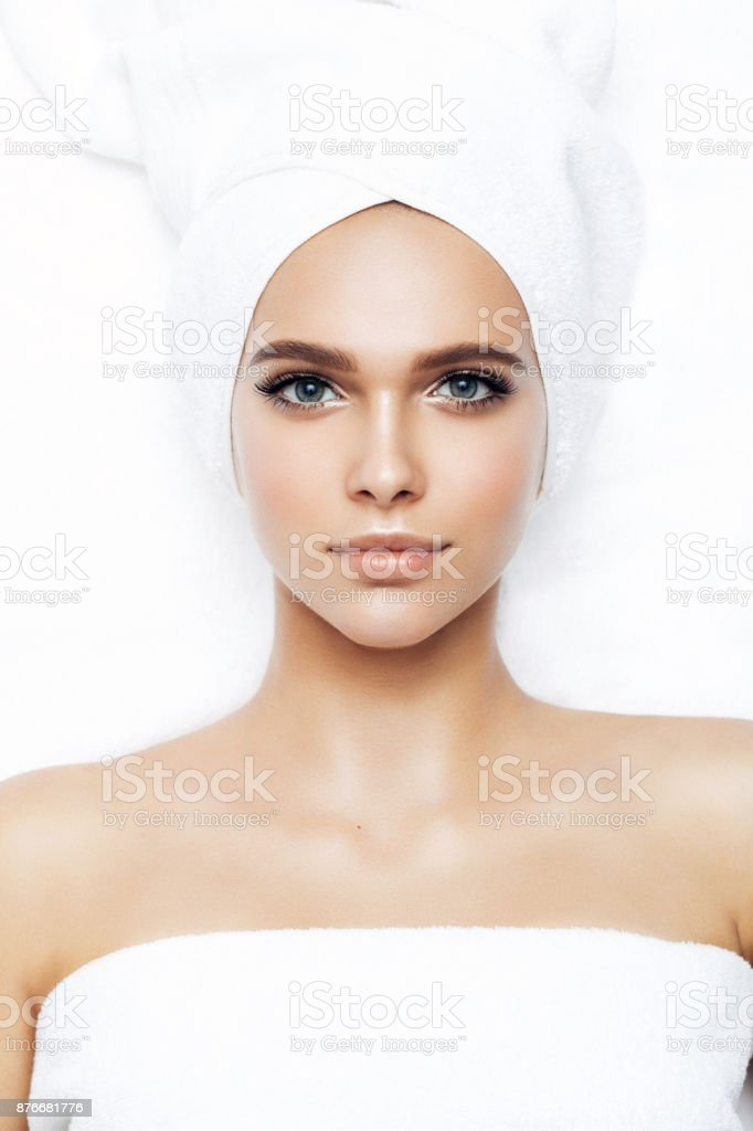 Woman wrapped in towel laying down stock photo