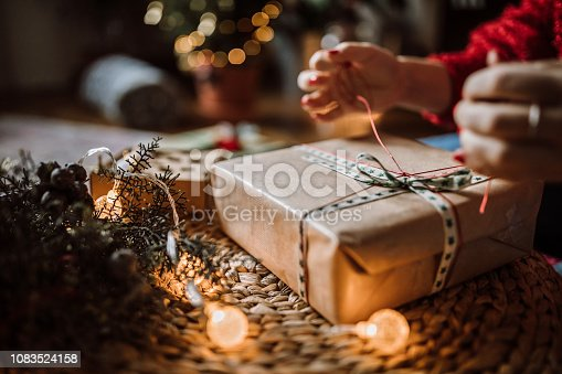 istock Woman Wrapping Christmas Gifts 1083524158