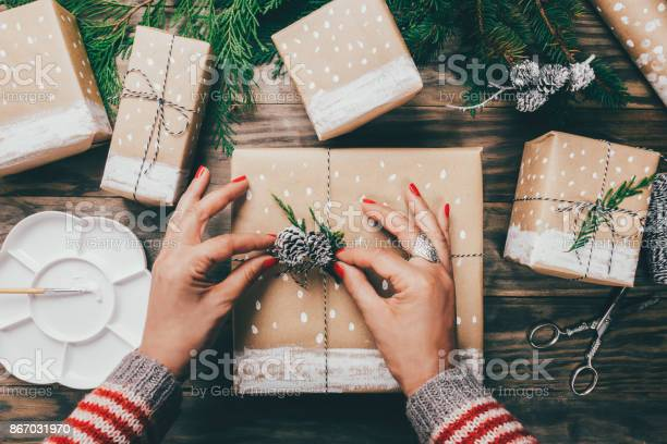 Woman wrapping christmas presents in a crafty way picture id867031970?b=1&k=6&m=867031970&s=612x612&h=nyc3y6fx7sdeh326 evykc6pcmz9bbewevvy5v3izsc=