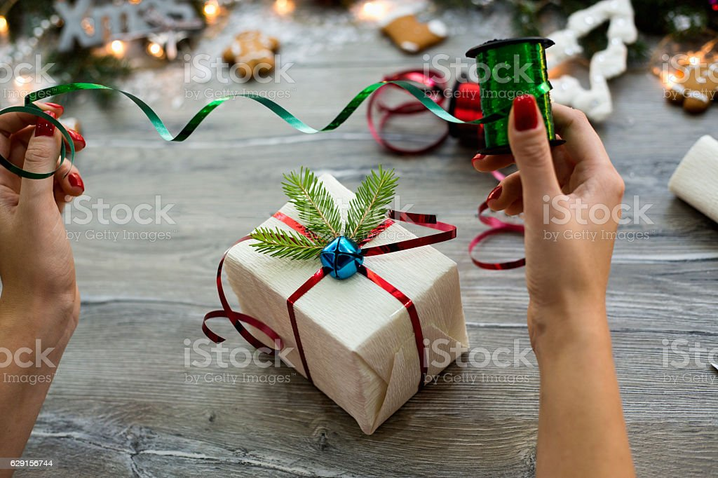 66f2c61deb9ca Woman Wrapping Modern Christmas Gifts Presents At Home Stock Photo -  Download Image Now