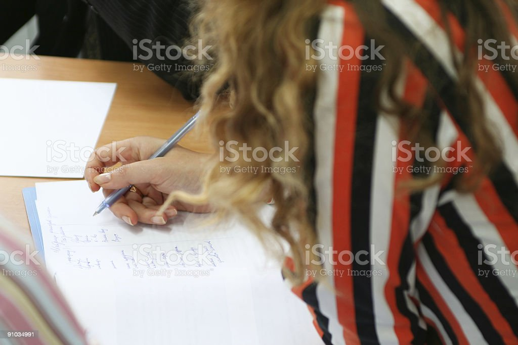 Woman write on the paper royalty-free stock photo