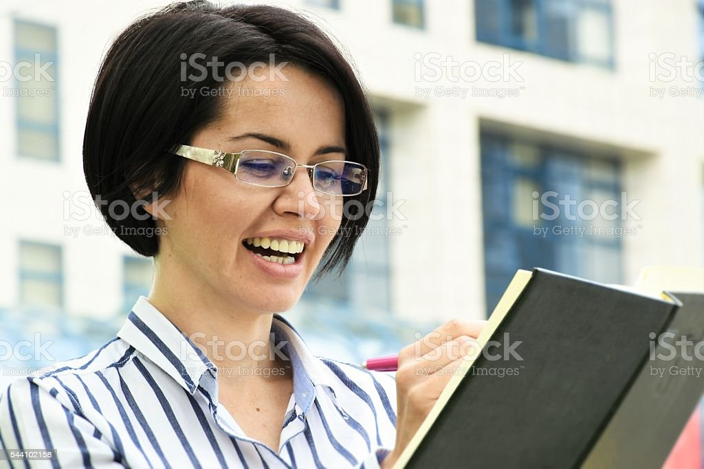 woman writes in the planner stock photo