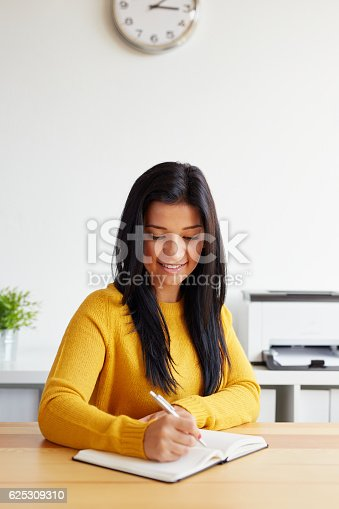 istock Woman writes notes in her diary 625309310