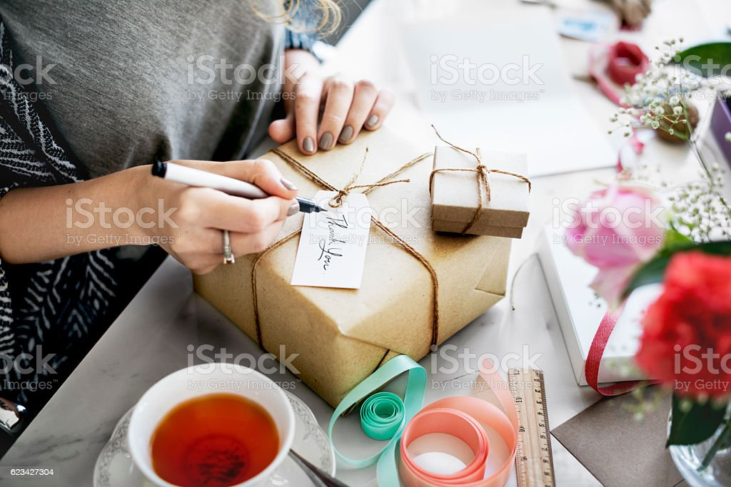 Woman Writing Card Gift Present Concept stock photo