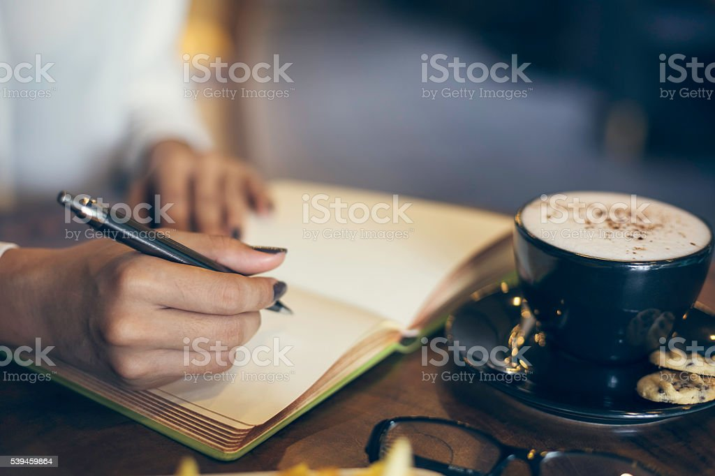woman writing her notebook stock photo