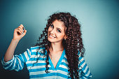 istock woman writing holding pen smiling happy 939281148