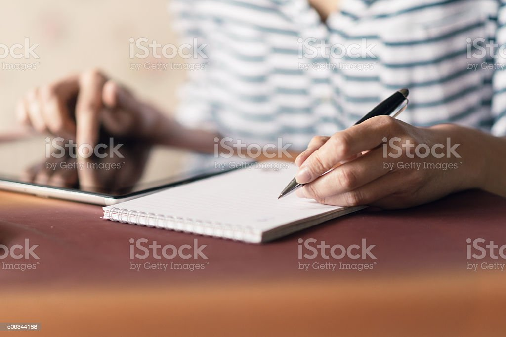 Woman Writing in a Notebook stock photo