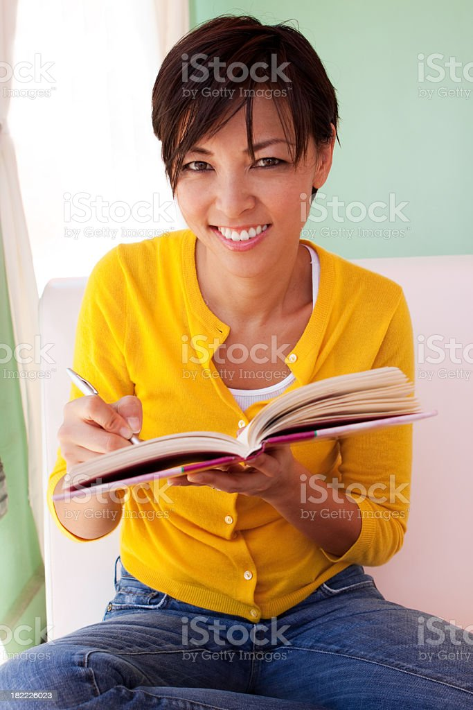 Woman writing in her journal royalty-free stock photo