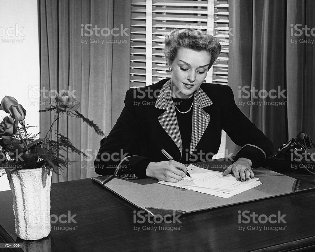 Woman writing royalty-free stock photo