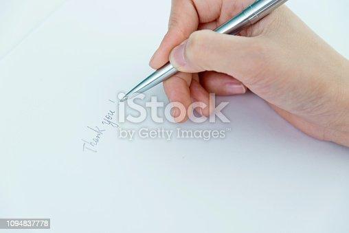istock Woman writing thank you on paper 1094837778