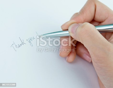 istock Woman writing thank you on paper 862553396