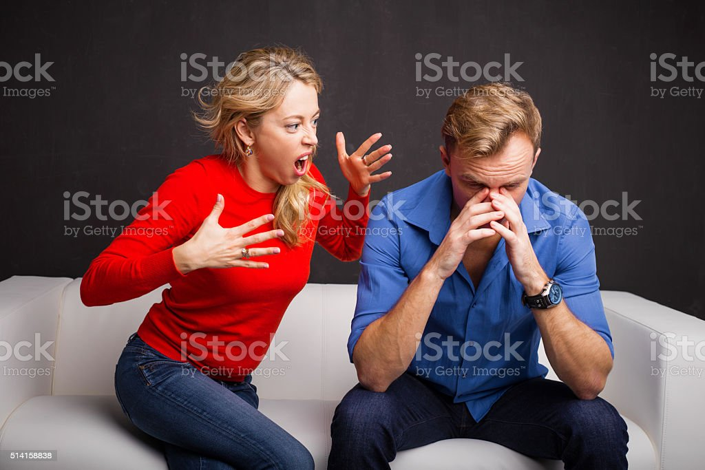 Woman yelling at man stock photo