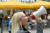 istock Woman yelling into a megaphone 496381558