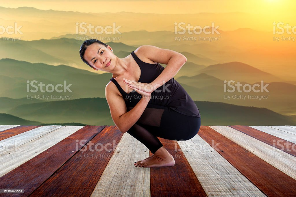 Asian woman doing yoga fitness exercise outdoor in beautiful...