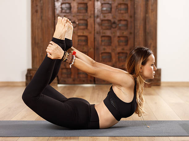 Woman yoga trainer in asana stock photo
